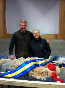 Fleece Show Judges; Jude Anderson and Tim Hey with the Judges's choice fleece.